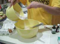 Sifting the ingredients for pizzelles